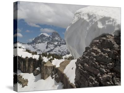 A Snow Cornice on a Ridge in Front of Teton Range-Greg Winston-Stretched Canvas Print