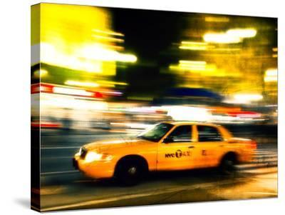 A NY Taxi Cab Rushes By-Jorge Fajl-Stretched Canvas Print
