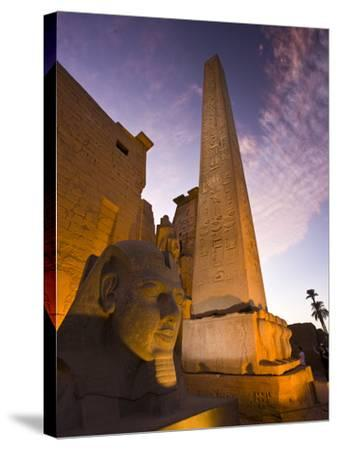 An Obelisk and Sphinx Head at the Entrance to Luxor Temple-Michael Melford-Stretched Canvas Print
