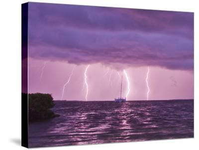 Lightning Bolts Striking the Ocean, and Almost Hitting a Sailboat-Mike Theiss-Stretched Canvas Print