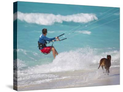 A Kiteboarder and His Dog Enjoying Gusty Winds from Hurricane Tomas-Mike Theiss-Stretched Canvas Print