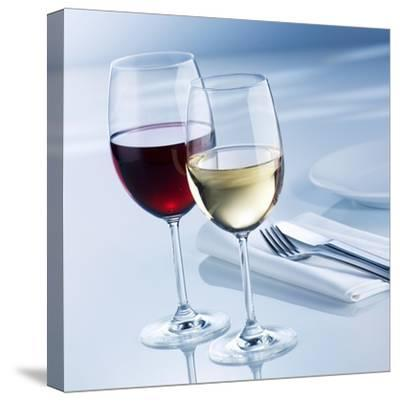 Glass of White Wine and Glass of Red Wine Beside Place-Setting-Alexander Feig-Stretched Canvas Print