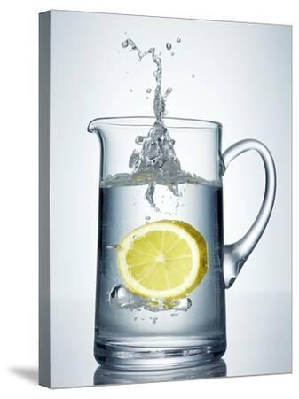 Lemon Falling into Jug of Water-Petr Gross-Stretched Canvas Print