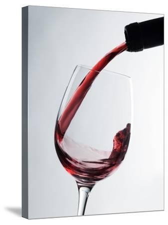 Pouring Red Wine-Caroline Martin-Stretched Canvas Print
