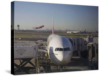 Boeing 777-300 ER Jet Airliner of Emirates Airline at Gate, Sydney Airport, Australia-Nick Servian-Stretched Canvas Print
