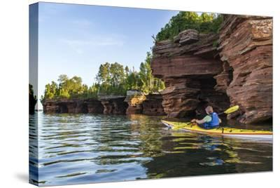 Kayaker in Sea Caves, Devils Island, Apostle Islands National Lakeshore, Wisconsin, USA-Chuck Haney-Stretched Canvas Print