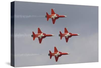 Bright Red Jets Flying in Formation At an Air Show-Joe Petersburger-Stretched Canvas Print