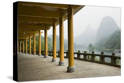 The Li River Runs Past a Covered Walkway by the Karst Formations-Jonathan Kingston-Stretched Canvas Print