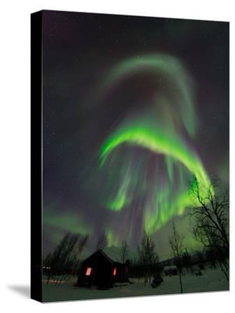 The Aurora Borealis Over a Sami Village House-Babak Tafreshi-Stretched Canvas Print