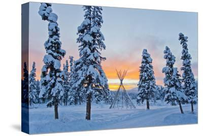 Orange Sky at Sunset Over Snow-covered Evergreens and a Tee Pee Form-Mike Theiss-Stretched Canvas Print