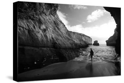 A Stand Up Paddleboarder on the Rough Coastline North of Santa Cruz-Ben Horton-Stretched Canvas Print