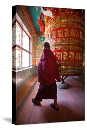 A Monk Spins the Worlds Largest Prayer Wheel Near Boudhanath Stupa-Ben Horton-Stretched Canvas Print