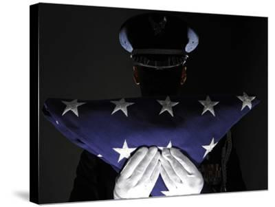 U.S. Airman Stands at Attention After Completing the Flag Dressing Sequence-Stocktrek Images-Stretched Canvas Print