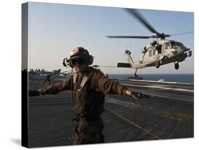 Airman Checks For a Clear Deck As An MH-60S Sea Hawk Takes Off USS John C. Stennis-Stocktrek Images-Stretched Canvas Print
