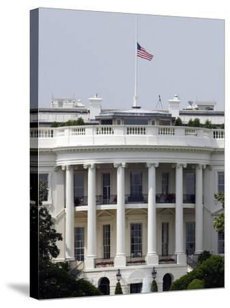 The American Flag Flies at Half-staff Atop the White House-Stocktrek Images-Stretched Canvas Print