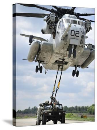 U.S. Marines Conduct a Sling Load Operation with a CH-53E Super Stallion-Stocktrek Images-Stretched Canvas Print