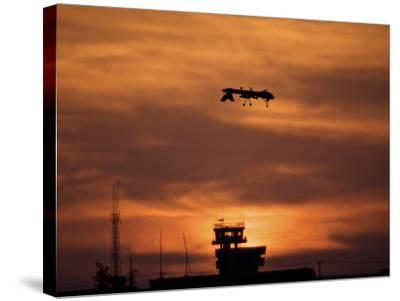 A MQ-1 Predator Over COB Speicher at Sunset, Tikrit, Iraq-Stocktrek Images-Stretched Canvas Print