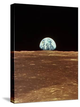 Apollo 11 View of Earth Rising Over Moon's Horizon--Stretched Canvas Print