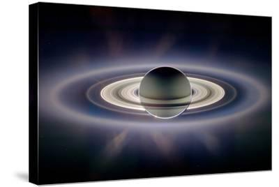 Saturn Silhouetted, Cassini Image--Stretched Canvas Print