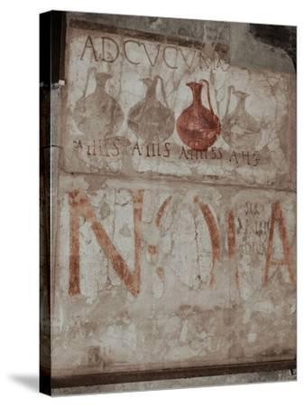 """A Wine Shop Sign in the Main Street, Advising to """"Come to the Sign of the Bowls"""" (Ad Cucumas)--Stretched Canvas Print"""
