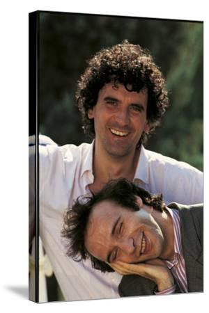 Portrait of Roberto Benigni and Massimo Troisi Smiling--Stretched Canvas Print