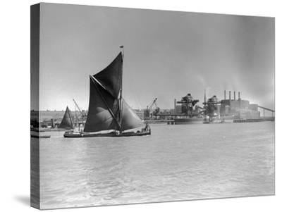 Sailboat Passes Ford Motor Works--Stretched Canvas Print