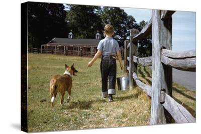 Boy and His Dog Walking Along a Fence-William P^ Gottlieb-Stretched Canvas Print