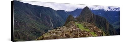 Ruins of Buildings at an Archaeological Site, Inca Ruins, Machu Picchu, Cusco Region, Peru--Stretched Canvas Print