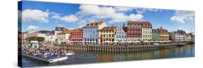 Tourists in a Tourboat with Buildings Along a Canal, Nyhavn, Copenhagen, Denmark--Stretched Canvas Print