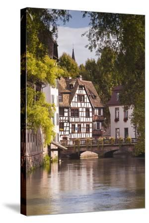 Half Timbered Houses in La Petite France-Julian Elliott-Stretched Canvas Print