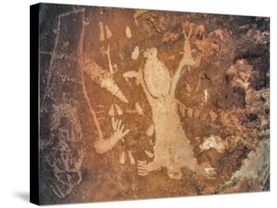 A Rare Anasazi Petroglyph on a Sandstone Boulder Thought to Depict Childbirth-David Hiser-Stretched Canvas Print