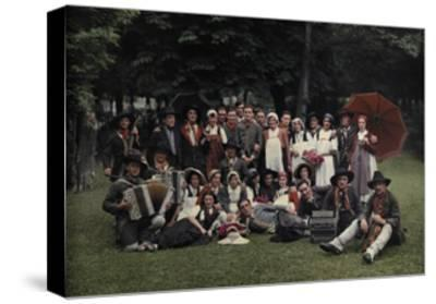 A Large Group of Peasants Pose at the Geneva Folk Costume Festival-Hans Hildenbrand-Stretched Canvas Print