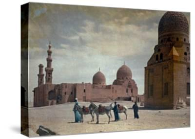 Men Lead Donkeys Past the Tombs of the Caliphs-Hans Hildenbrand-Stretched Canvas Print