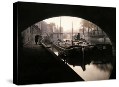 A View of Ile-De-La-Cite from under a Bridge-Gervais Courtellemont-Stretched Canvas Print