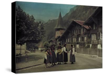 A Group of Mothers and Daughters Pose on a Village Street Corner-Hans Hildenbrand-Stretched Canvas Print
