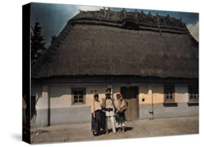 Three People Stand in Front of a House after Returning from Work-Hans Hildenbrand-Stretched Canvas Print