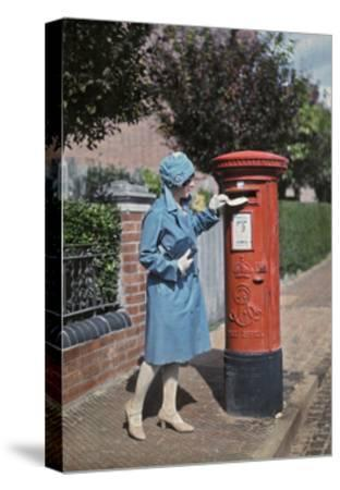 A Young Woman Mails a Letter at the Pillar Box-Clifton R^ Adams-Stretched Canvas Print