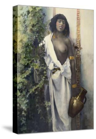 A Bedouin Woman Half Draped in White Cloth Stands Holding an Urn--Stretched Canvas Print