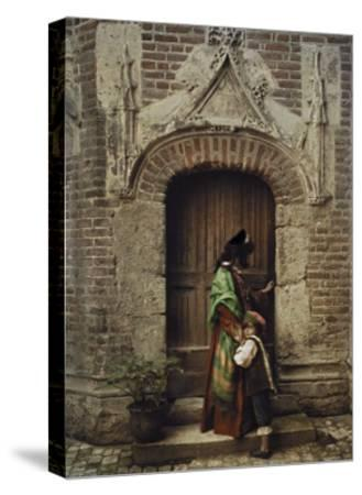 A Woman and Child Use the Yard Door to Exit the Castle-Gervais Courtellemont-Stretched Canvas Print
