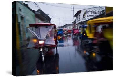 Traffic Headlights Swirl Past an Auto Rickshaw on a Rainy Night in an Amazon River Town-Jason Edwards-Stretched Canvas Print