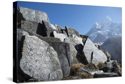 Mani Stones Inscribed with an Ancient Tibetan Mantra in the Khumbu Valley-Alex Treadway-Stretched Canvas Print