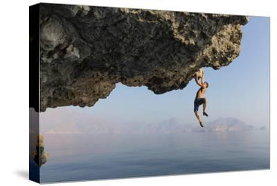 A Climber Dangles from an Overhang-Jimmy Chin-Stretched Canvas Print