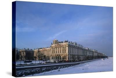 Russia, Saint Petersburg, Hermitage Museum and Ice Covered Neva River--Stretched Canvas Print
