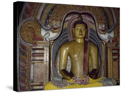 Painted Statue of Buddha Kept in Rock Temple Dating from 18th Century, Dambulla, Sri Lanka--Stretched Canvas Print