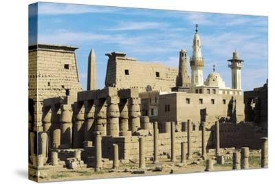 Egypt, Ancient Thebes Luxor, Temple of Amon, Ruins and Pylon of Ramses II in Background--Stretched Canvas Print