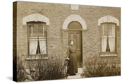 Woman Standing Outside Reuben Cottage--Stretched Canvas Print