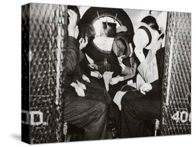 Gangsters in a Patrol Wagon on their Way to Dewey's Office--Stretched Canvas Print