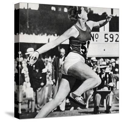 Olga Fikotova of Czechoslovakia Setting a New Olympic Record in the Final of the Women's Discus--Stretched Canvas Print