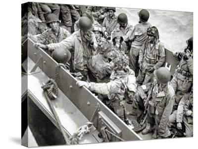 A Group of Glider Pilots Is Returning to England in a Landing Craft, Vehicle, Personnel--Stretched Canvas Print