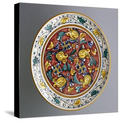 Round Dish with Floral Decorations on Carmine Red Background--Stretched Canvas Print